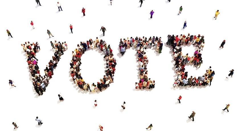 Group of people spelling the word vote.
