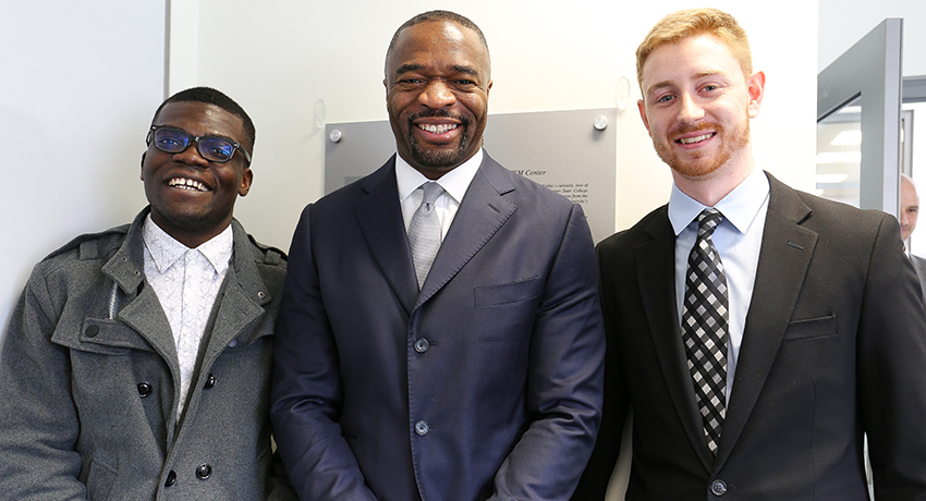 Alumnus and donor Imo Aisiku with Worcester State University students