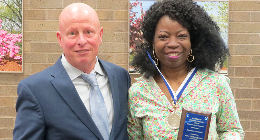 Binienda Center Director Mark Wagner presents a nursing award to WSU graduate nursing student Joyce Opoku-Agyeman.