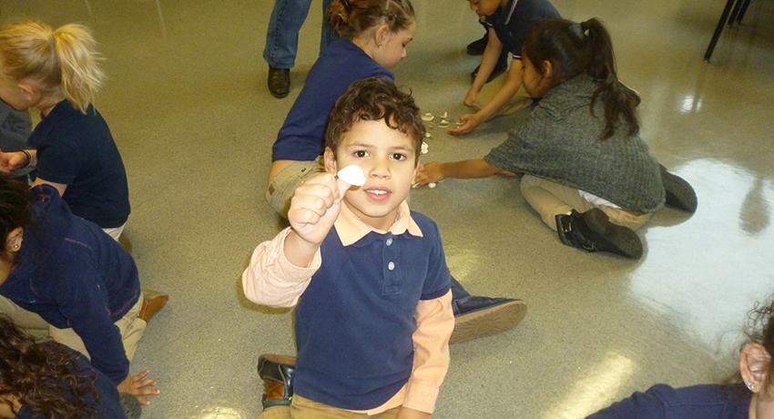 A Chandler Magnet kindergartener shows his seashell.