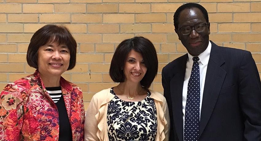 Worcester State University alumna Renah Razzaq (center) with Professor of Education Sue Foo and Associate Dean of Education Raynold Lewis