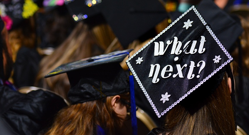 Worcester State University commencement mortarboard with a what's next message