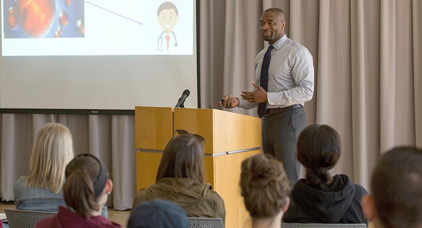 Imoigele Aisiku gives a lecture at Worcester State University.