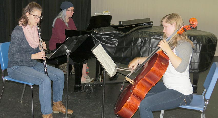 Worcester State trio rehearsing Beethoven Trio B-flat Major