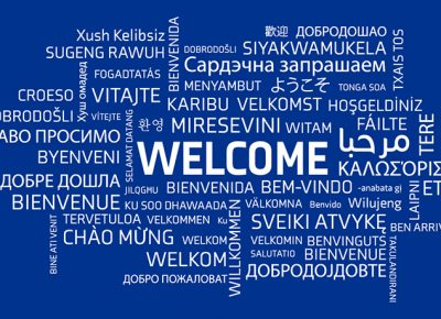 welcome word cloud graphic with blue background