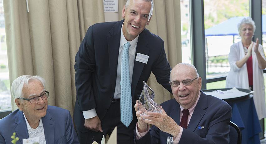 Alumnus Robert Mullin holds the Freelander Award.